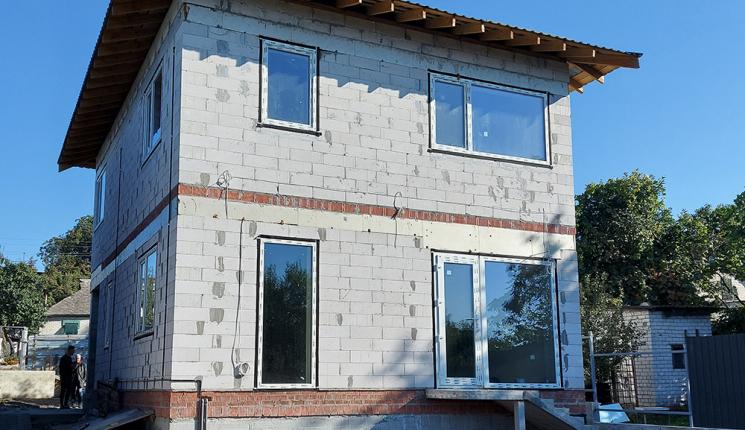 Двухэтажный дом с подвалом